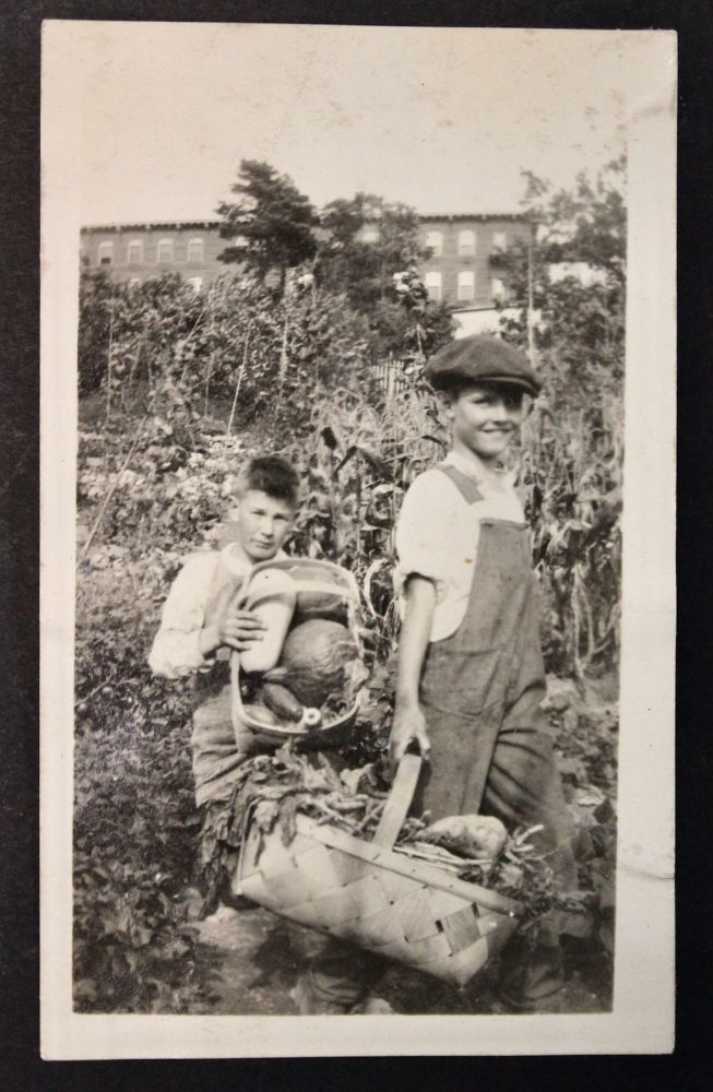 Photo album documenting the student gardeners at the Mary Hemenway School in Boston, participating in the United States School Garden Army (USSGA) program during and after World War I. Education, World War I.
